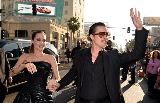 """HOLLYWOOD, CA - MAY 28: Actors Angelina Jolie (L) and Brad Pitt attend the World Premiere of Disney's """"Maleficent"""" at the El Capitan Theatre on May 28, 2014 in Hollywood, California. (Photo by Kevin Winter/Getty Images)"""