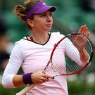 Simona Halep of Romania celebrates victory in her women's singles match against Alisa Kleybanova on Tuesday