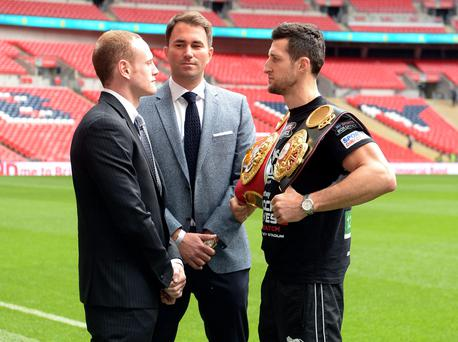Carl Froch (right) and George Groves (left) go head to head with Boxing Promotor Eddie Hearn during a Press Conference at Wembley Stadium today
