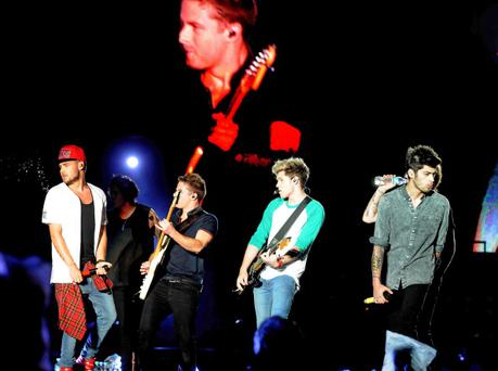 English-Irish pop band One Direction performs at Velez stadium in Buenos Aires on May 4, 2014 early morning. LAURA TENEMBAUM/AFP/Getty Images)
