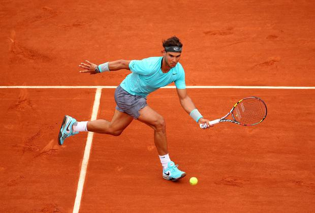 Rafael Nadal returns a shot during his win over Austrian Dominic Thiem at the French Open yesterday. Photo: Clive Brunskill/Getty Images