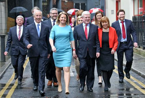 Former Labour Party leader Eamon Gilmore with party colleagues before last week's disastrous elections for the party