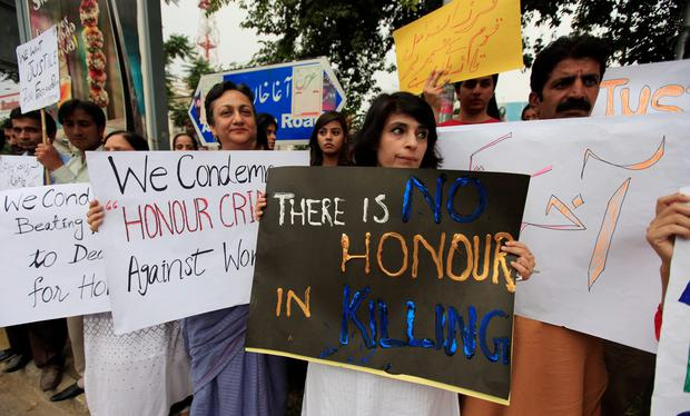Members of civil society and the Human Rights Commission of Pakistan hold placards during a protest in Islamabad against the killing of Farzana Iqbal