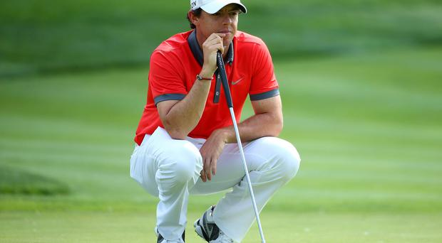 Rory McIlroy studies the 13th green during the first round of the Memorial Tournament at Muirfield