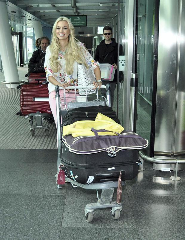 Former Miss World Rosanna Davison and new husband Wesley Quirke seen with her family at Dublin Airport. Picture: John Dardis