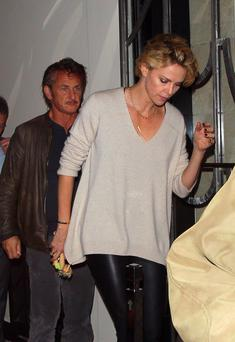 Charlize Theron and Sean Penn leaving Claridges Hotel in London