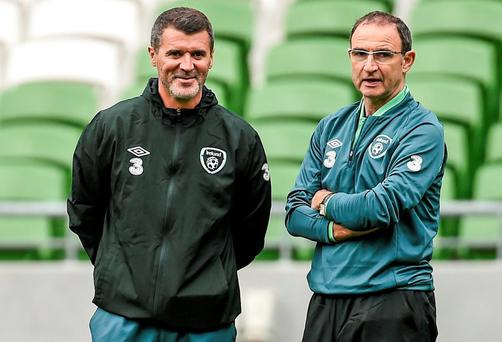 Republic of Ireland manager Martin O'Neill, right, speaks with assistant coach Roy Keane