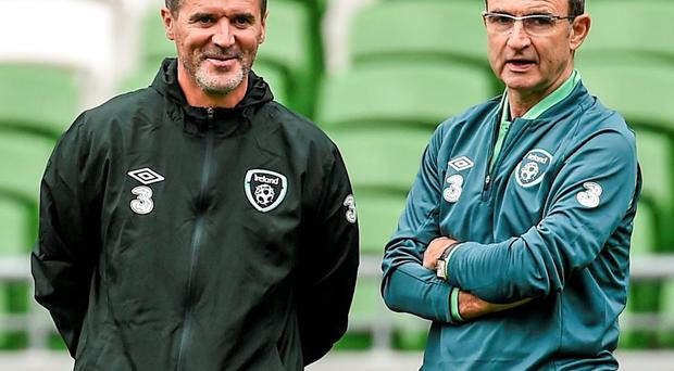 Republic of Ireland manager Martin O'Neill, right, speaks with assistant coach Roy Keane. Picture credit: Ramsey Cardy / SPORTSFILE