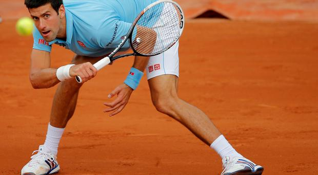 Serbia's Novak Djokovic returns the ball to Croatia's Marin Cilic during their third round match of the French Open tennis tournament at the Roland Garros stadium, in Paris
