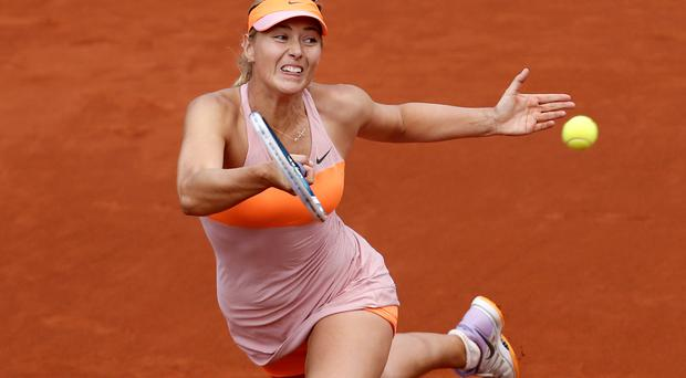 Russia's Maria Sharapova returns the ball during the third round match of the French Open tennis tournament against Argentina's Paula Ormaechea at the Roland Garros stadium, in Paris