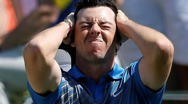 Rory McIlroy reacts in frustration after a bogey on the 18th hole at the Memorial golf tournament in Dublin, Ohio