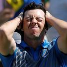 Rory McIlroy, of Northern Ireland, reacts after a bogey on the 18th hole at the Memorial golf tournament in Dublin, Ohio. (AP Photo/The Columbus Dispatch, Adam Cairns)