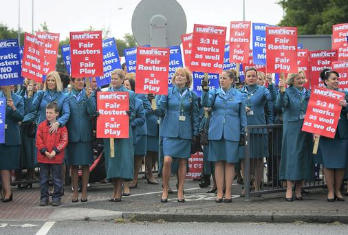 Aer Lingus cabin crew during a 24 hour strike over rosters at Dublin Airport on the June Bank Holiday weekend - further planned strikes have now been called off. Photo: Gareth Chaney Collins