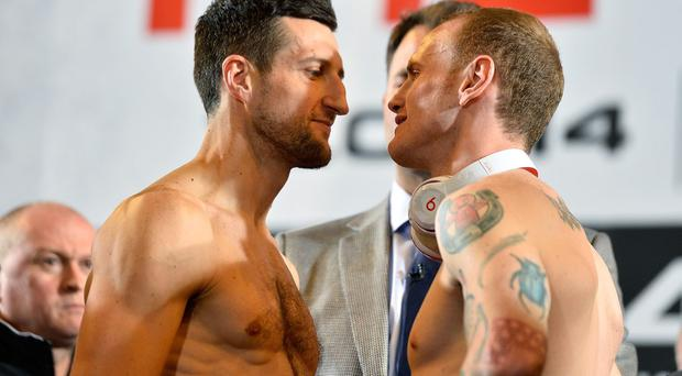 Carl Froch (left) and George Groves go head to head during the official weigh-in at Wembley Arena ahead of their fight tonight