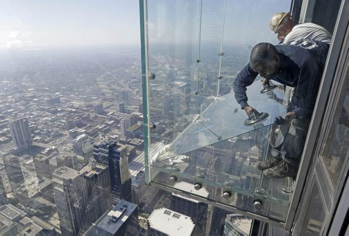 Workers replacing the coating on the Ledge after the glass appeared to crack