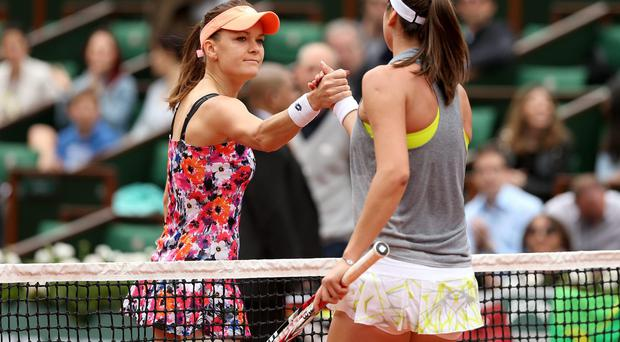 World number three Agnieszka Radwanska shakes hands with Ajla Tomljanovic after their match at the French Open yesterday. Photo: Matthew Stockman/Getty Images
