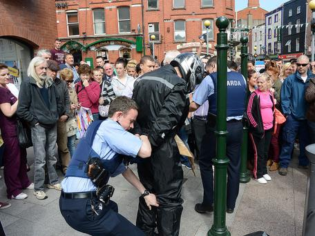 Gardai arrest a man after an off duty detective garda foiled a bank raid in Drogheda this afternoon. Photo: Colin Bell