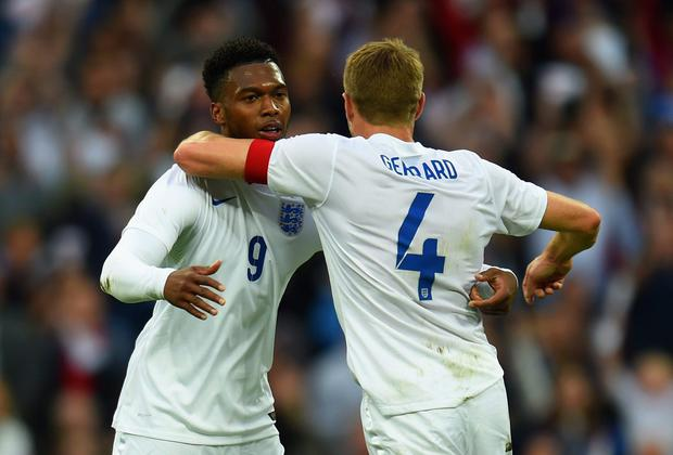 Steven Gerrard congratulates Daniel Sturridge after the England striker opened the scoring against Peru at Wembley with a subline curled effort into the top corner. Photo: Shaun Botterill/Getty Images