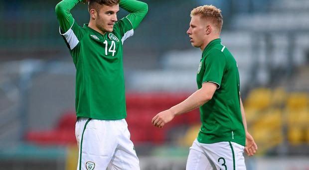 Ireland's Colm Crowe (left) and Bobby Moseley wonder where it went wrong at the final whistle after defeat against Turkey. Photo: Pat Murphy / SPORTSFILE