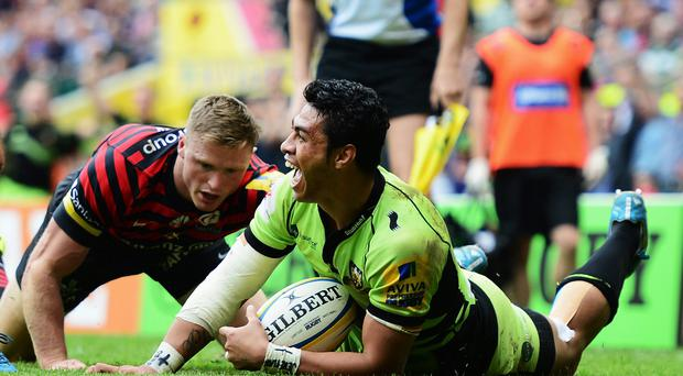 Chris Ashton of Saracens fails to stop George Pisi of Northampton Saints goes over to score their second try