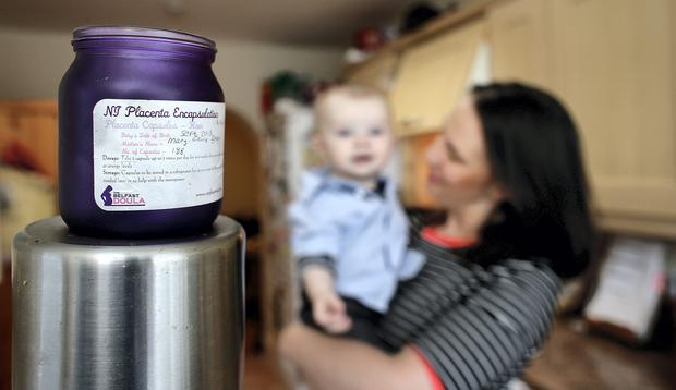 Mary Elaine Tynan with her son Donnacha and the placenta capsules. Picture: GERRY MOONEY