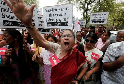 Demonstrators from All India Democratic Women's Association (AIDWA) hold placards and shout slogans during a protest against the recent killings of two teenage girls, in New Delhi. India's new Home Minister Rajnath Singh weighed in on Friday in a grisly case in which two teenage girls were raped and hanged from a tree this week in the northern Indian state of Uttar Pradesh, as public anger and political controversy over the attack gain momentum. REUTERS/Adnan Abidi