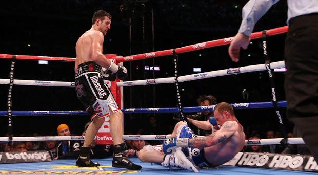 Carl Froch knocks down George Groves to win the IBF and WBA World Super Middleweight Title fight at Wembley Stadium