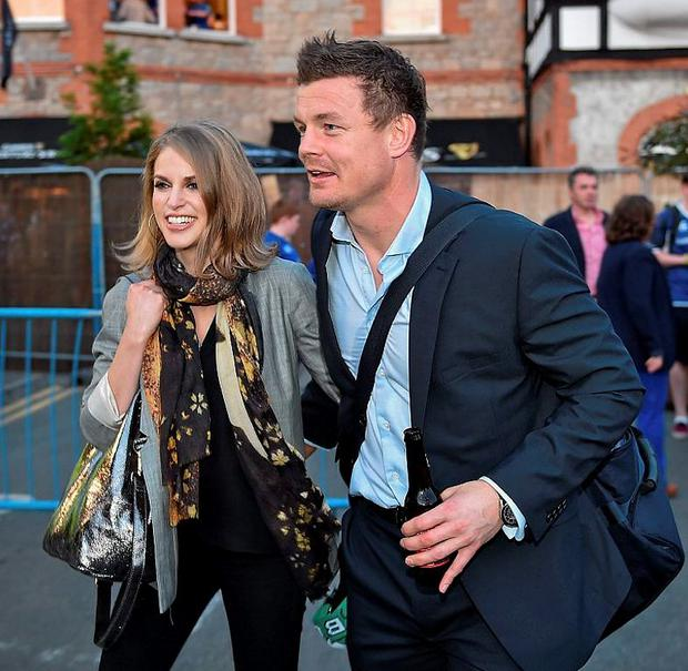 Brian O'Driscoll is greeted by his wife Amy Huberman