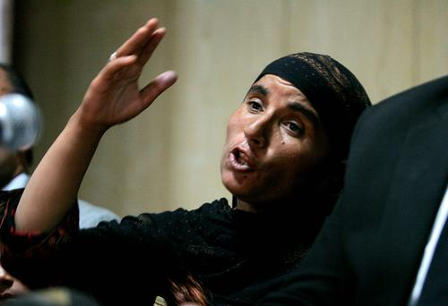 Khalida Bibi, sister of the late Farzana Iqbal, speaks during a news conference in Lahore. Reuters