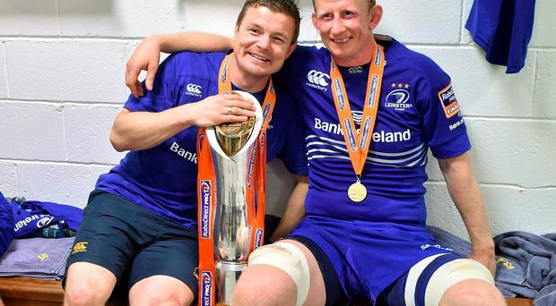 Brian O'Driscoll and fellow retiree Leo Cullen celebrate in the dressing room after Leinster's victory over Glasgow Warriors in the Pro12 final. Photo: Brendan Moran / SPORTSFILE
