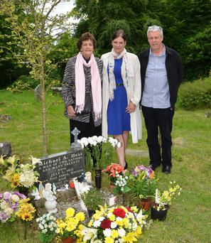Philomena Lee, daughter Jane and son Kevin at the grave of her son Michael A. Hess in Roscrea. Picture: PJ Wright