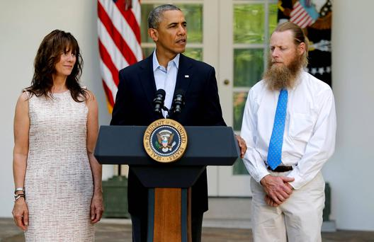 US President Barack Obama stands with Bob Bergdahl (R) and Jami Bergdahl (L) as he delivers a statement about the release of their son, prisoner of war US Army Sergeant Bowe Bergdahl, in the Rose Garden at the White House in Washington. Reuters