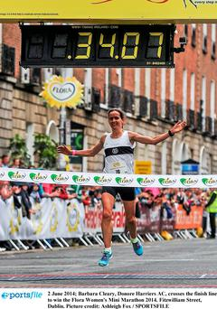 Barbara Cleary, Donore Harriers AC, crosses the finish line to win the Flora Women's Mini Marathon 2014. Photo: Ashleigh Fox / SPORTSFILE