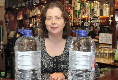 Alison Clarke of James Clarks bar in Boyle, Co. Roscommon finds it hard to run her business with out running clean water. Picture: Hany Marzouk