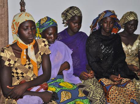 Some of the escaped kidnapped girls of the government secondary school Chibok, attend a meeting with Borno state governor, Kashim Shettima, in Maiduguri, Nigeria. (AP Photo/Jossy Ola)