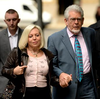 Rolf Harris arrives at Southwark Crown Court, London, with daughter Bindi. PA