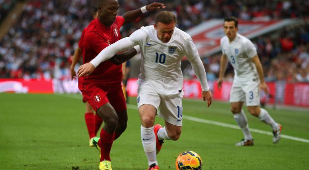 Wayne Rooney could find himself starting England's World Cup games from the bench, with Roy Hodgson having a difficult decision to make on whether to include him ahead of his on-form players. Photo: Clive Rose/Getty Images