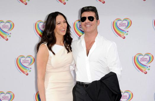 Simon Cowell and the mother of his baby Eric, Lauren Silverman. (Photo by Stuart C. Wilson/Getty Images)