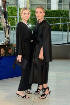 Designers Ashley Olsen (left) and Mary-Kate Olsen attend the 2014 CFDA fashion awards