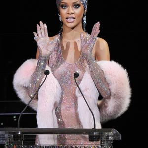 Rihanna speaks onstage at the 2014 CFDA fashion awards