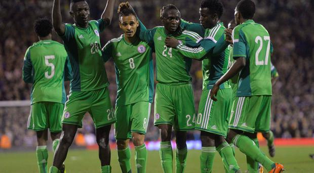 Nigeria's Uche Nwofor (3rd R) celebrates with teammates after scoring against Scotland during their international friendly soccer match at Craven Cottage