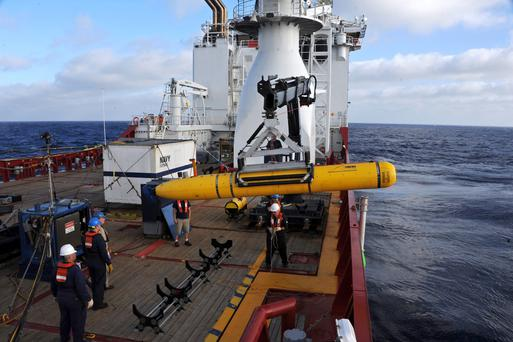 Crew aboard the Australian Defence Vessel Ocean Shield move the U.S. Navys Bluefin-21 into position for deployment in the southern Indian Ocean April 14, 2014 to look for the missing Malaysian Airlines flight MH370 in this picture released by the U.S. Navy. Australia's deputy prime minister on May 29, 2014 said officials remained confident the missing Malaysia Airlines jet is somewhere in southern Indian Ocean despite searchers saying wreckage was not on the seabed in the area they had identified. Photo: Reuters
