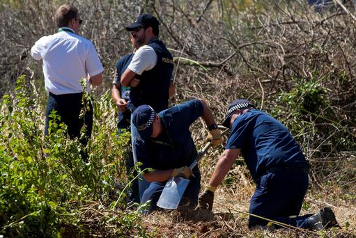 Scotland Yard detectives and Portuguese polices work at an area in Praia da Luz, near Lagos. Reuters/Carlos Vidigal