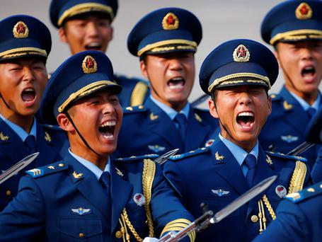 Soldiers from the honour guards of the Chinese People's Liberation Army (PLA) shout as they march during a welcoming ceremony for Kuwait's Prime Minister Sheikh Jaber al-Mubarak al-Sabah at the Great Hall of the People in Beijing. REUTERS/Petar Kujunzic