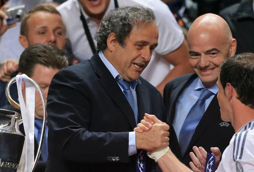 UEFA President Michel Platini shakes hands with Real Madrid's Gareth Bale during the UEFA Champions League Final at at the Estadio da Luiz, Lisbon, Portugal. PA