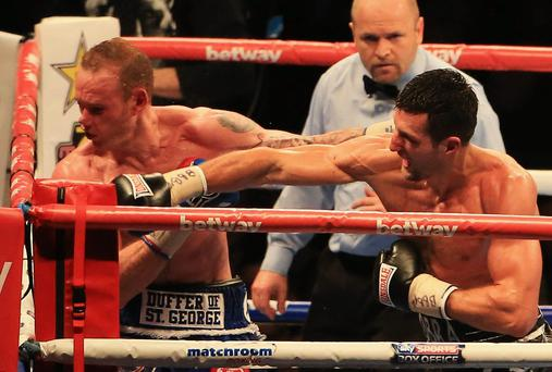 Carl Froch, right, knocks out George Groves during the IBF & WBA World Super Middleweight title fight at Wembley Stadium