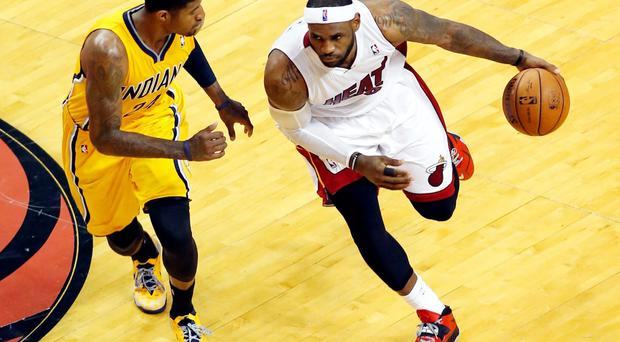 Miami Heat forward LeBron James (6) drives to the basket against Indiana Pacers