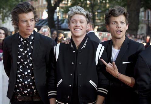 Members of boy band One Direction, (L-R) Harry Styles, Niall Horan and Louis Tomlinson
