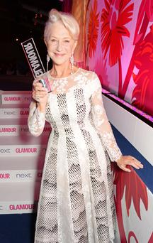 Glamour Icon award winner Dame Helen Mirren pose at the Glamour Women of the Year Awards