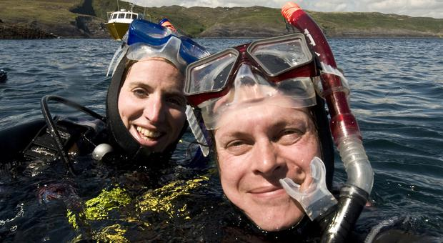 Two snorkellers surface after a dip